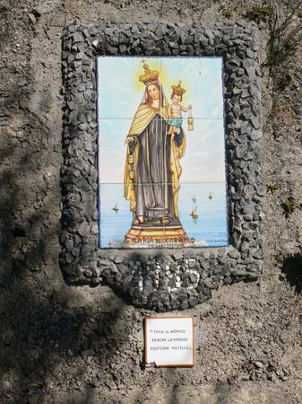 Madonna ceramic, in most doorways in these villages