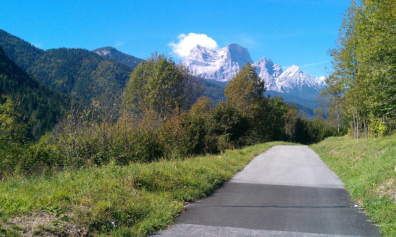 """It was fantastic to get to ride along such a great bike path with no auto traffic.  In the distance is """"God's throne"""" - a spectacular mountain peak."""