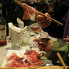 Our patron demonstrates the correct way of eating the prosciutto with the breadsticks.