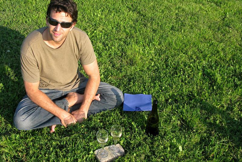 Makeshift picnic in the grass with the local white, Malvasia