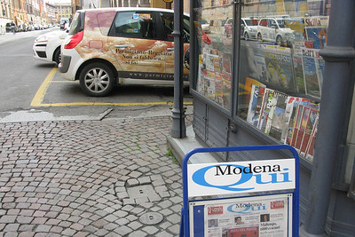 You gotta love a city advertising Parmigiano-Reggiano cheese on its tiny cars.
