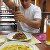 In Bologna, tagliatelle with Bolognese ragu and a curly pasta called gramigna with sausage and saffron...heaven on two plates.