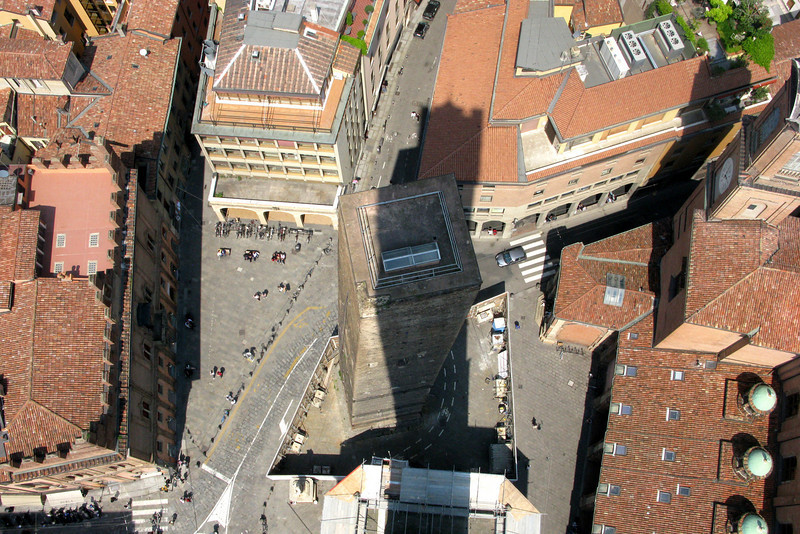 Looking down on the piazza below and, in the tower's shadow, the square top of Torre degli Garisenda