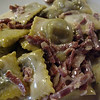 Radicchio-filled raviolini with prosciutto crudo in a butter-cream sauce...decadence on a plate