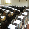 All of the barrels are left unsealed; there's an opening under each white cloth. After at least 12 years, a small amount of vinegar is withdrawn from the smallest cask, then each cask gets topped off with the next largest cask, which holds the next oldest vintage vinegar.