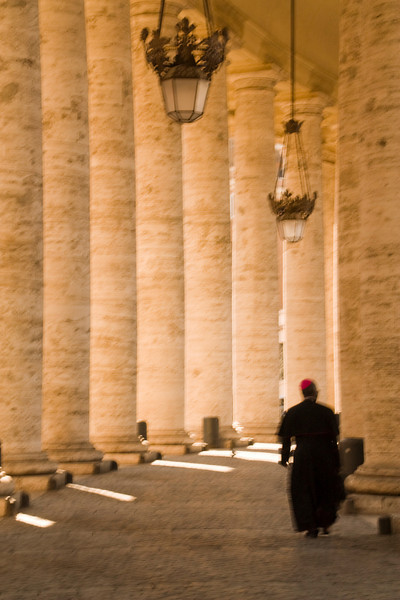 A bishop walks past me as I was trying to capture the light & shadows from the hall of columns.