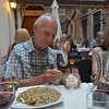Jim adds parmigiana reggiano to his risotto con fungi enjoyed at Osteria Leon Bianco in Venice near the Accademia.  July 19, 2016.