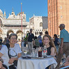 Family group enjoying refreshments in Saint Marks Square at Cafe Eden.<br /> July 19, 2016