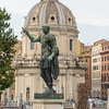 Statue of Trajan, Roman emperor from 98 to 117 AD. He was very  successful as soldier-emperor who presided over the greatest military expansion in Roman history, leading the empire to attain its maximum territorial extent.  The church of Santissimo Nome di Maria is behind.