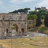 The Arch of Constantine as viewed from the Colosseum. The largest Roman triumphal arch, it spans the way taken by the emperors when they entered the city in triumph.  It  commemorates Constantine I's victory over Maxentius at the Battle of Milvian Bridge in 312.