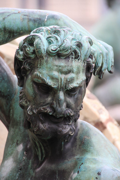 One of the faces in the fountain outside the Ufizzi Museum in Florence.  One of the few bronze ones around