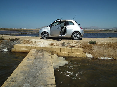 A small car can go down narrow streets and over salt pan roads.