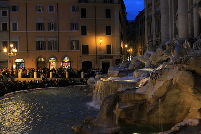 Dusk and crowds at the Trevi fountain.