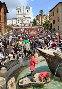 Kids playing in the fountain at the base of the Spanish Steps.