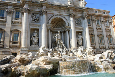 The Trevi fountain - central figure of Neptune flanked by two Tritons, one trying to master an unruly sea-horse, and the other leading a quieter beast, symbolising the two contrasting moods of the sea.