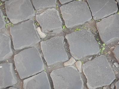 wine corks in the cobblestones