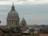 This is a view near the top of the Spanish steps, the dome further back is St. Peter's Basilica in Vatican City.