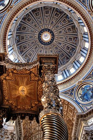 Michelangelo's Dome and Bernini's Papal Altar Canopy in St. Pater's Basilica in Rome, Italy.