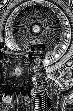 Michelangelo's Dome and Bernini's Papal Altar Canopy in St. Pater's Basilica in Rome, Italy in black & white.