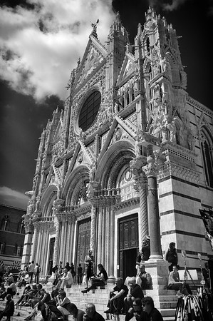 People on the steps of the cathedral in Siena, Italy