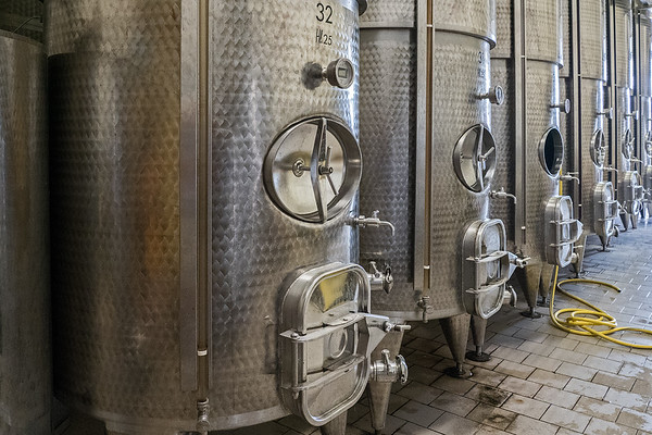 Stainless steel fermenters at winery