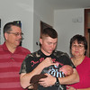 It looks like Conner is getting his dad wrapped around his finger while grandma and grandpa look on.
