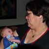 Conner looking at his proud grandma.