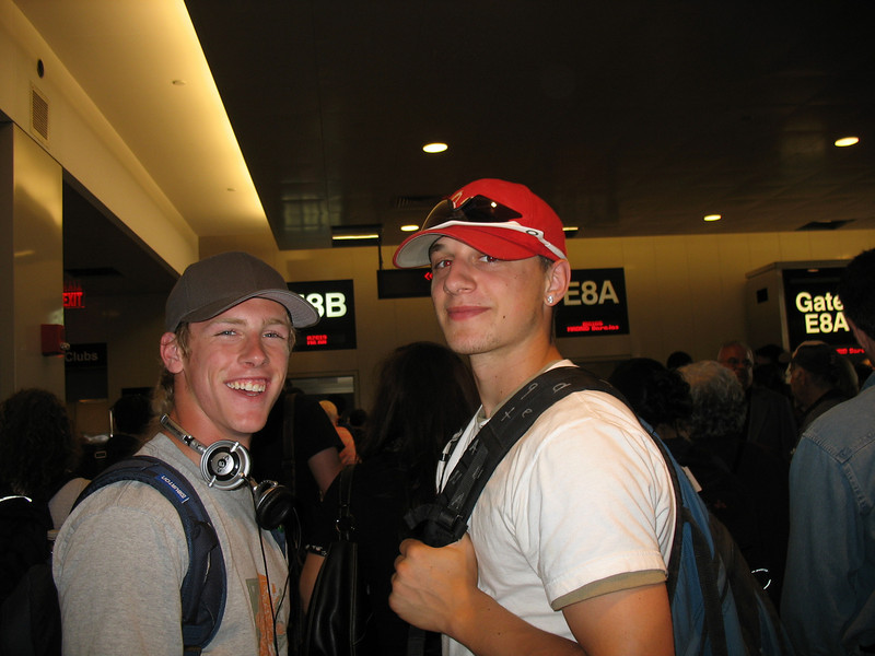 Ross and Kyle waiting to board the plane at Logan