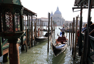 Gondola station (San Marco Vallaresso) on the Grand Canal, with Santa Maria della Salute in the background.