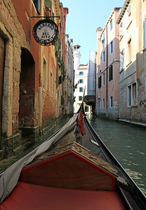 Riding a gondola along the back canals of Venice...