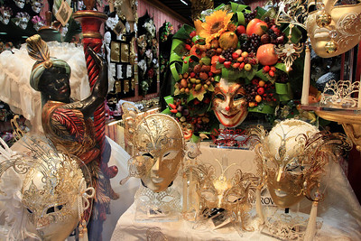 Exquisite masks in the shop window of a mask shop.