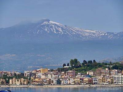 Mt Etna smoking over Taormina, Sicily