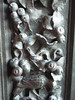 Close-up of door panel frames - pomegranates and pigeons in cast bronze