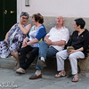 Catching up with friends on a village bench