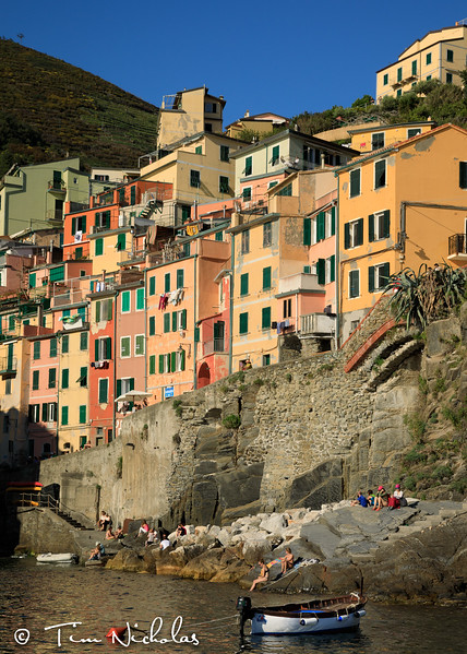Late afternoon view of the harbour houses of Riomaggiore