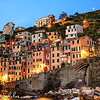 Post sunset view of the harbour houses of Riomaggiore