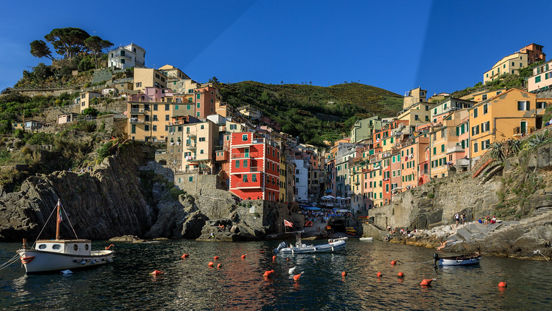 Late afternoon view of the harbour of Riomaggiore