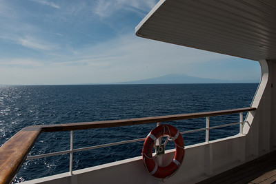 On board the Aegean Odyssey. We are sailing north along Sicily, gliding past Mount Etna.