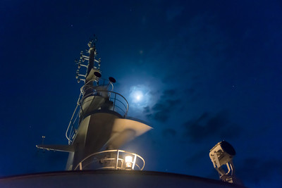 On board the Aegean Odyssey. On a moonlight night somewhere off the west coast of Italy.