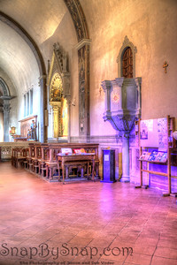 Fiesole, Italy –Quiet Charm – Here, inside the sanctuary on the monastery of San Francisco, the light coming through the stained glass gives this little church a dream like charm.  I was in here for about a half an hour enjoying the peace before I began my descent into the noise of the village.