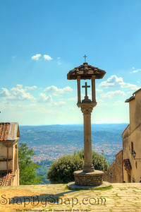 Fiesole, Italy - Holy See - In the courtyard of the monastery of San Francisco, you can look down this pathway and see Florence in the distance.  After escaping the chaos of Naples and the peak tourist season of Florence, this was a very relaxing place.