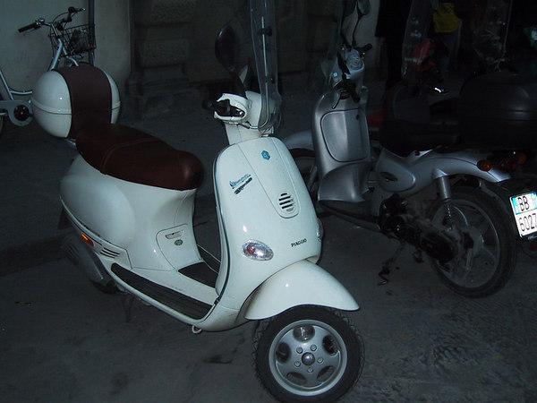 Yes, Italians really do ride Vespas.