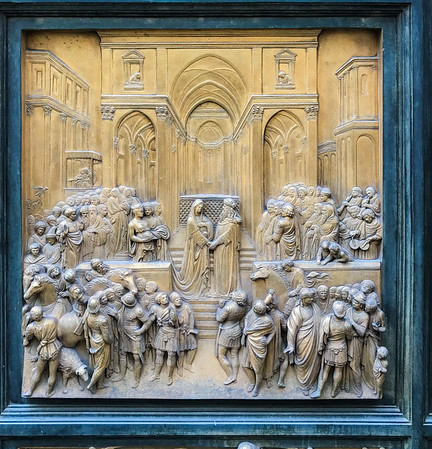 Lorenzo Ghiberti's gilded bronze doors at the Baptistery of Saint John. Michelangelo referred to these doors as fit to be the Gates of Paradise.