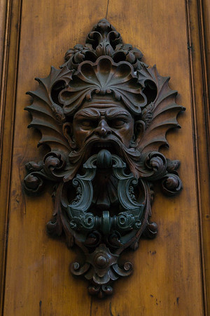Low relief iron door knocker