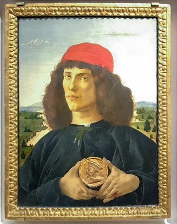 Portrait of a Man holding Medallion