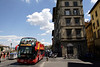 Double decker Tourist bus travelling along the Lungarno Torrigiani Florence