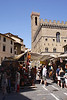 Street market Piazza Di San Firenze Florence with The Bargello in background
