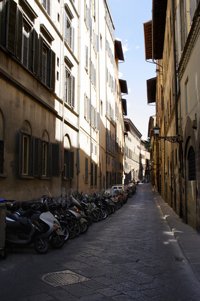 Motorcycles parked in the street Florence
