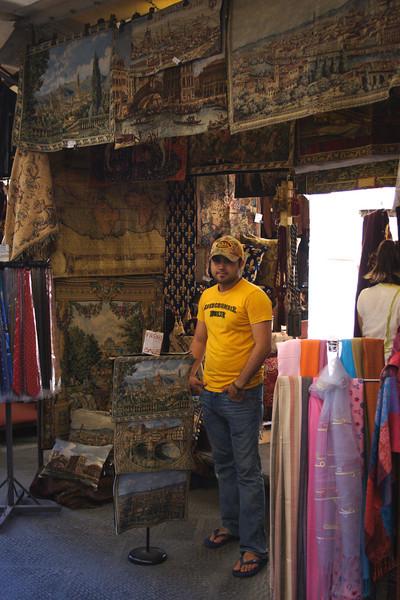 Tapestry stall at San Lorenzo street market Florence July 2007