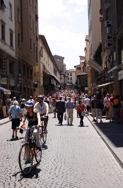 Street scene on the Via Por Santa Maria Florence towards Ponte Vecchio